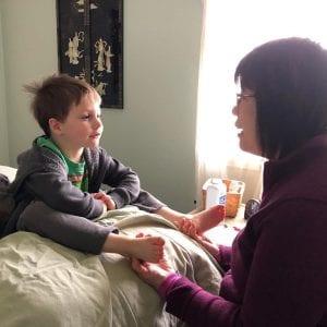 child listening to woman Reflexology Healing Medfield MA