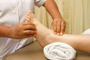 Hands giving reflexology treatment Reflexology Healing Medfield MA