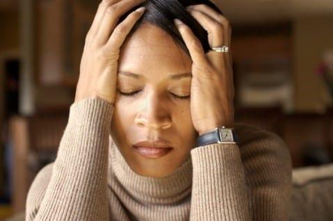 stress woman holding head